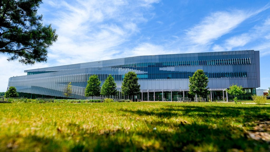 An exterior shot of the ultramodern Hunt Library on NC State's Centennial Campus.