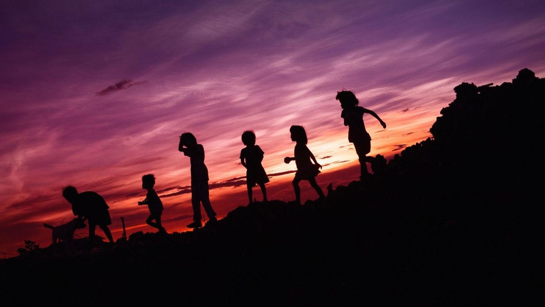 Kids playing at sunset
