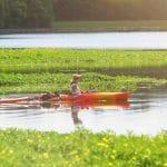 Women kayak at Lake Raleigh.
