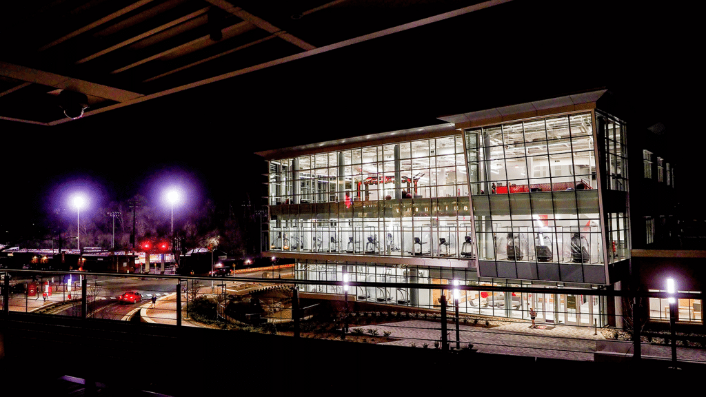 The exterior of NCState's Wellness and Recreation Center at night.