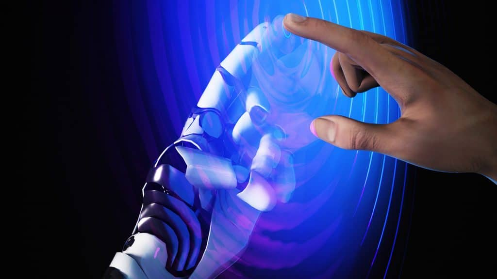 human hand and robotic hand touching via a liquid surface