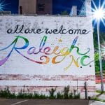 "A colorful mural that reads ""All are welcome. Raleigh N.C."""