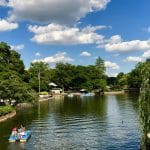 A family on a pedal boat at Pullen Park.