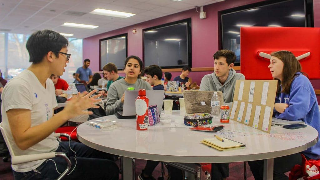 A student team discusses their solution to a sustainability challenge during Make-A-Thon