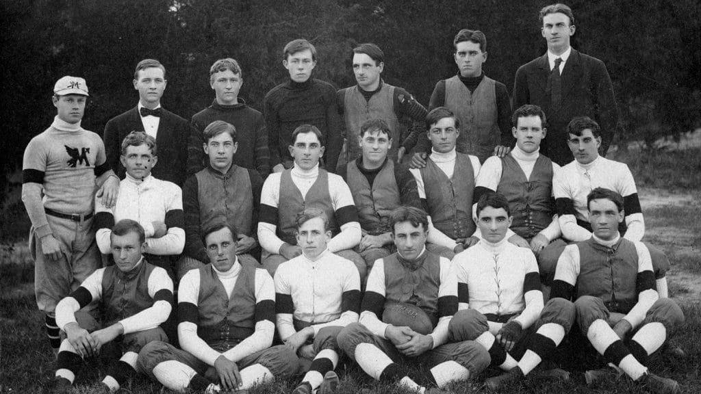 In a varsity team photo in 1907, Thompson is seated in the front row with the football. Sykes is the next player to the right.