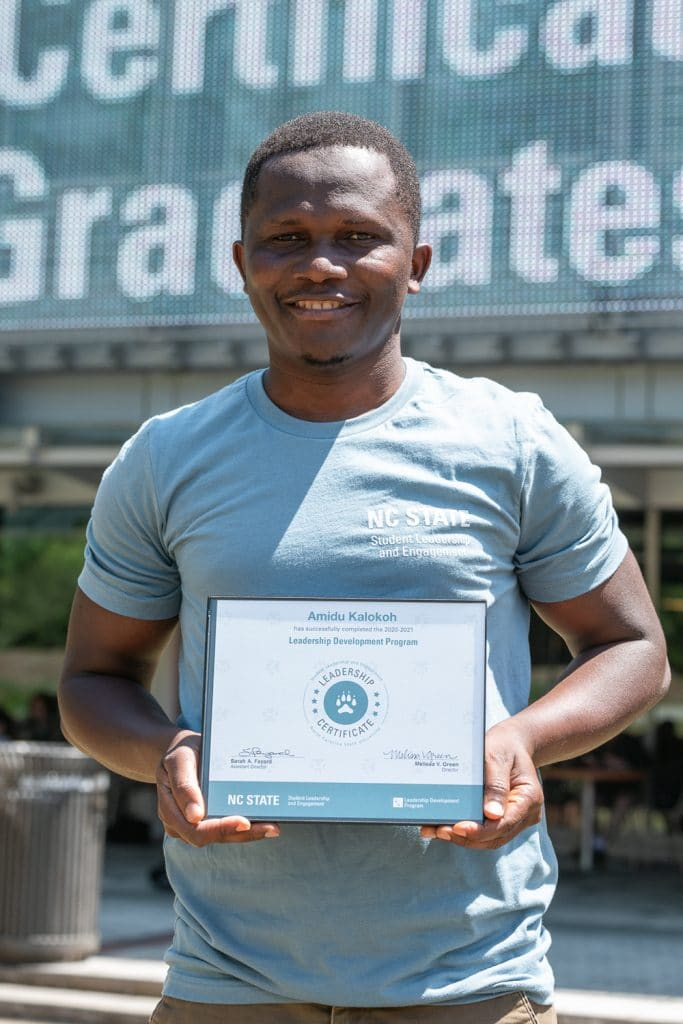 Amidu Kalokoh holds the Leadership Certificate he received from the Leadership Development Program in April.