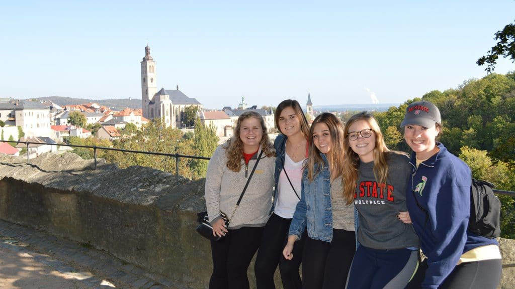 Sarah Phillips and four other NCState students take a picture overlooking the Church of St. James in Kutna Hora, Czech Republic.