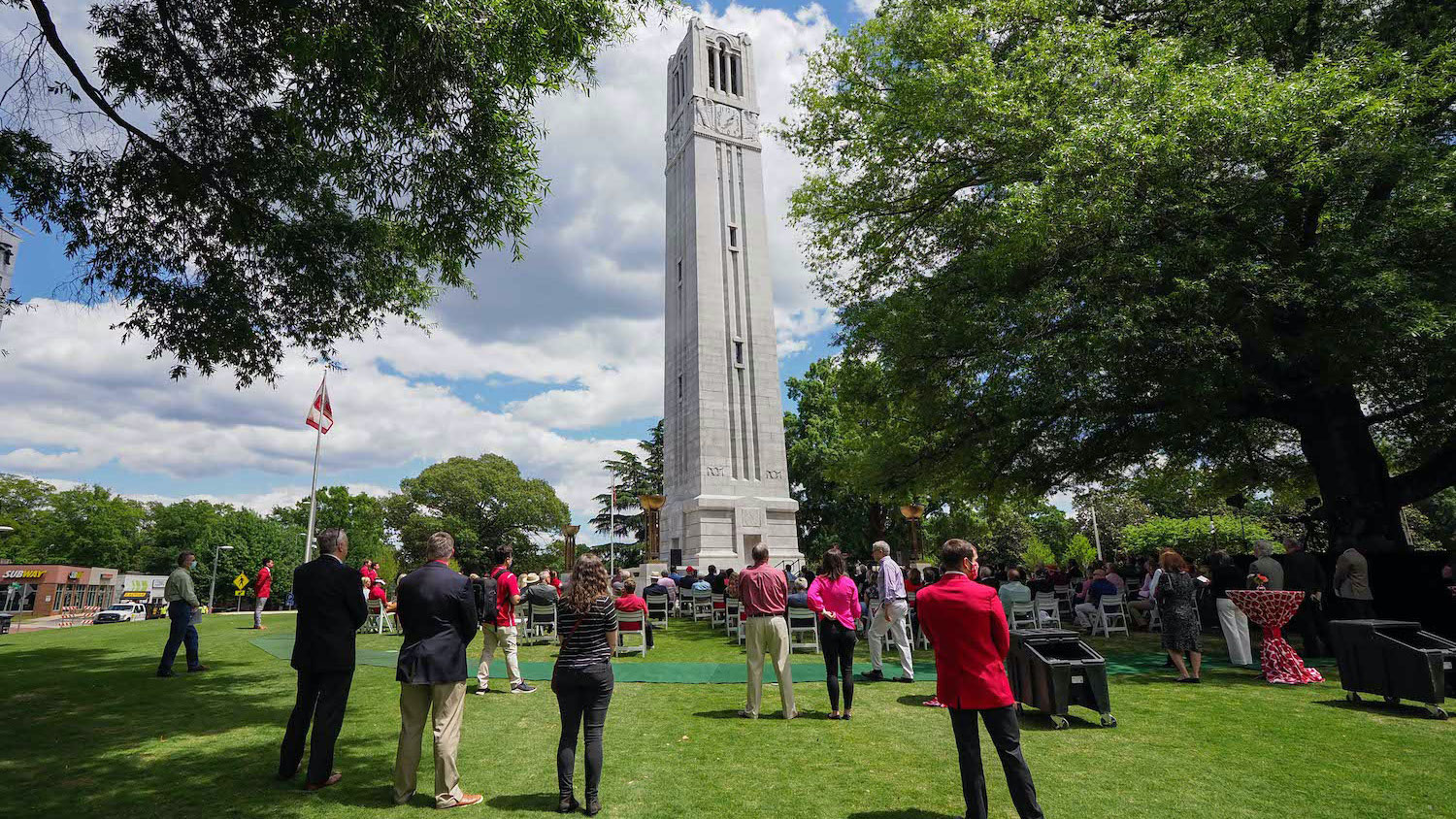 people gather for the Belltower reopening and dedication of Henry Square