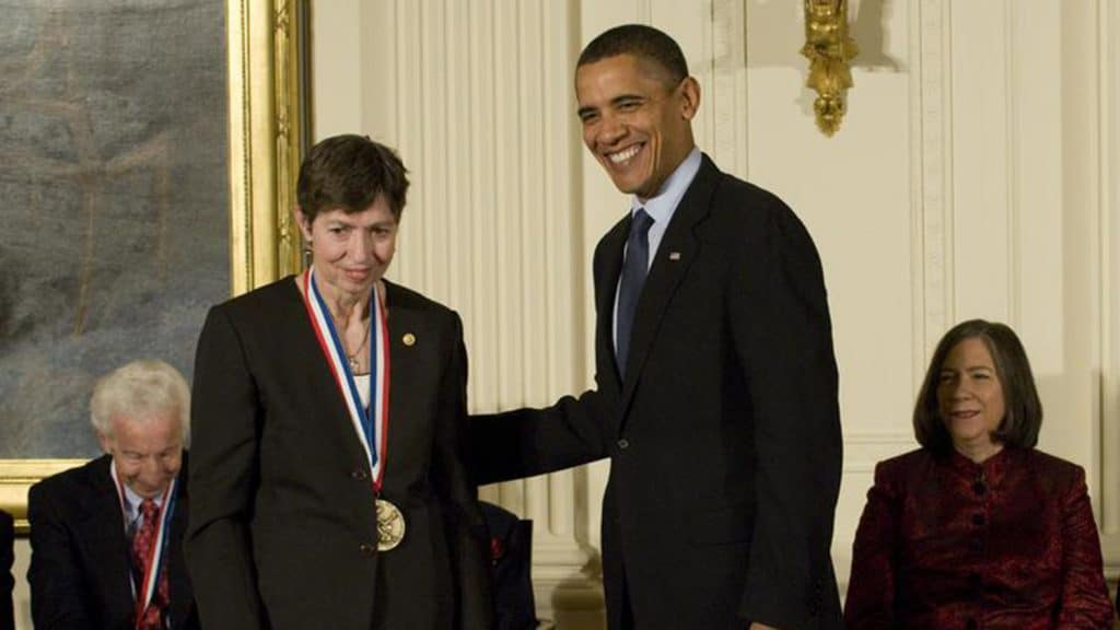 Marye Anne Fox standing next to President Obama at White House ceremony.