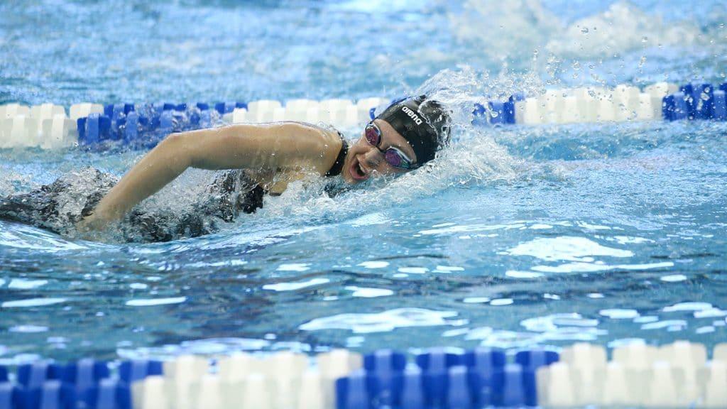 Sirena Rowe swimming side stroke in a pool.