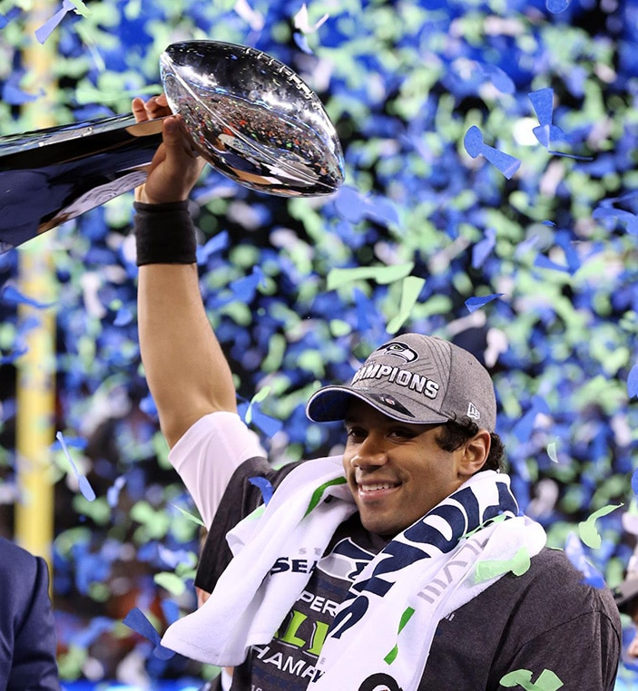 Russell Wilson hoists the Vince Lombardi Trophy at Super Bowl XLVIII in 2014.