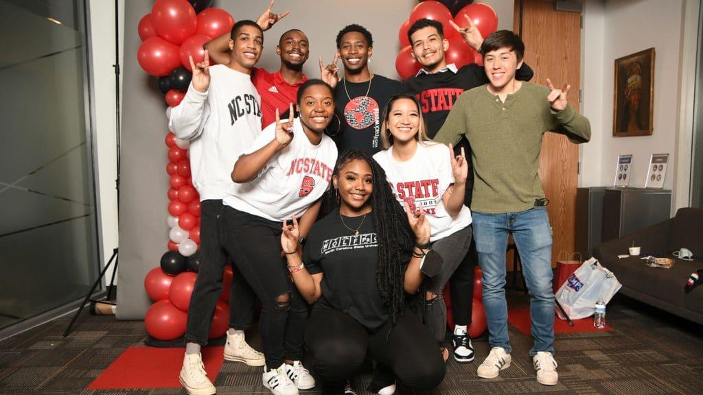 A diverse group of students celebrates graduation