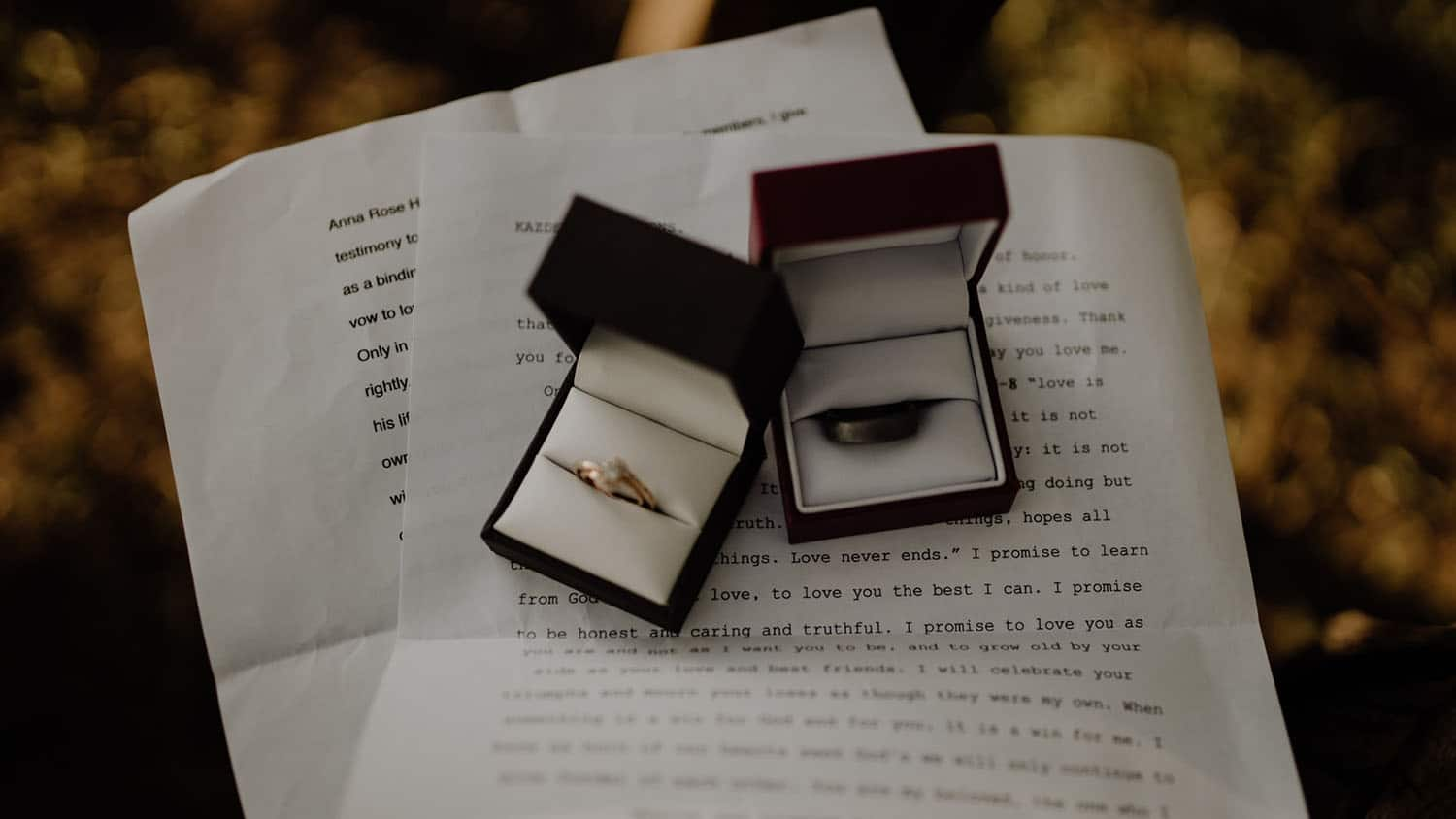wedding rings resting on top of a written document