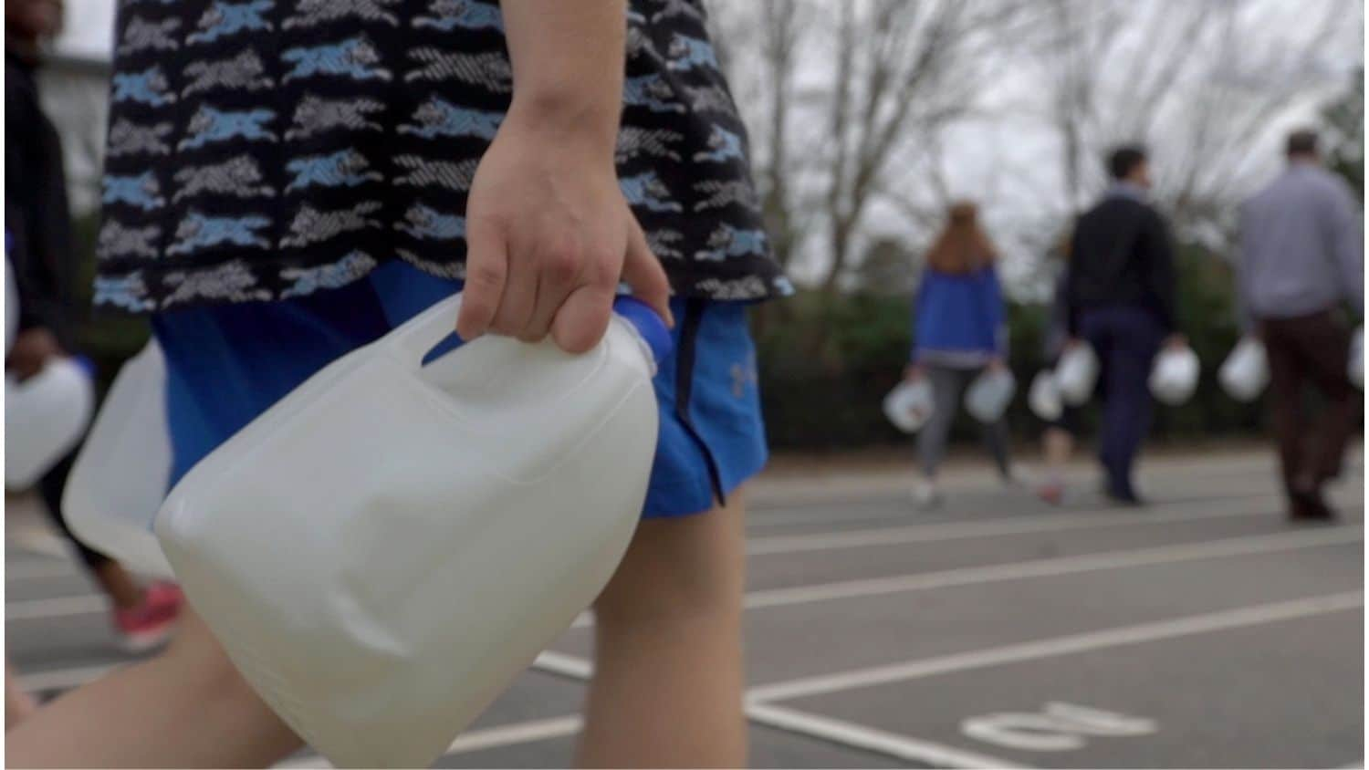 High school students carried water in a project designed to teach them about global water access.