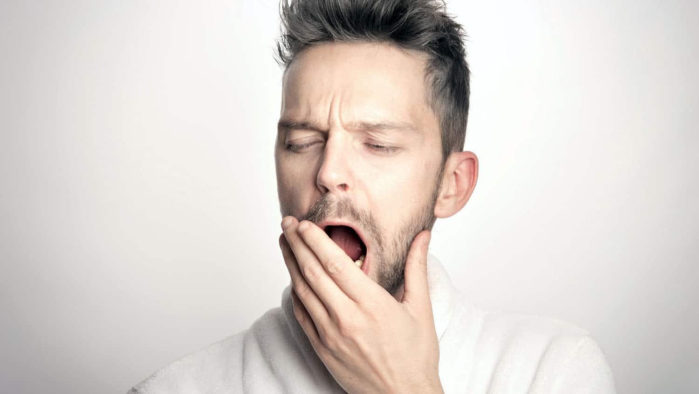 bored man yawns