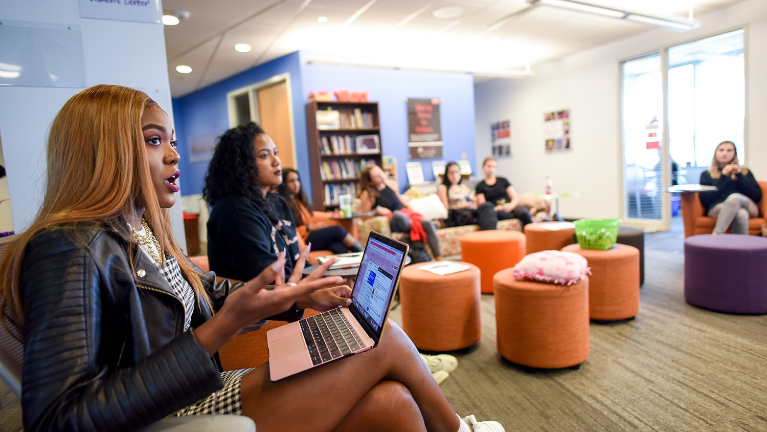 A group of students engages in discussion at the NCState Women's Center.