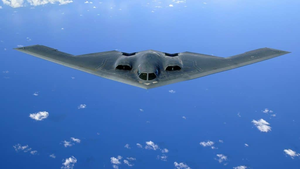 An aerial view of a B-2 Spirit stealth bomber mid-flight.