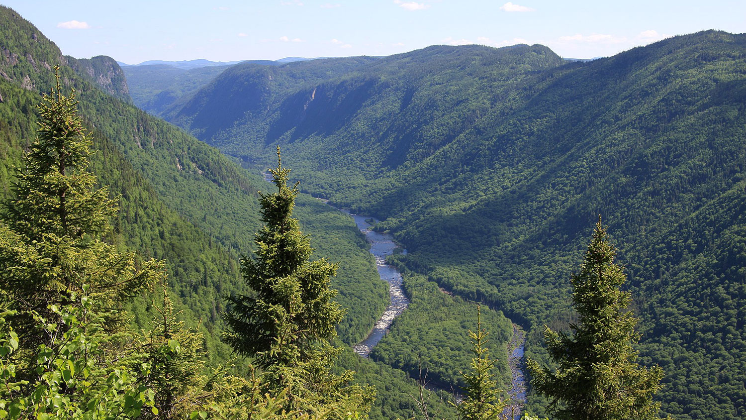 The Jacques-Cartier River runs between forested ridges in Jacques-Cartier National Park in Québec, Canada.