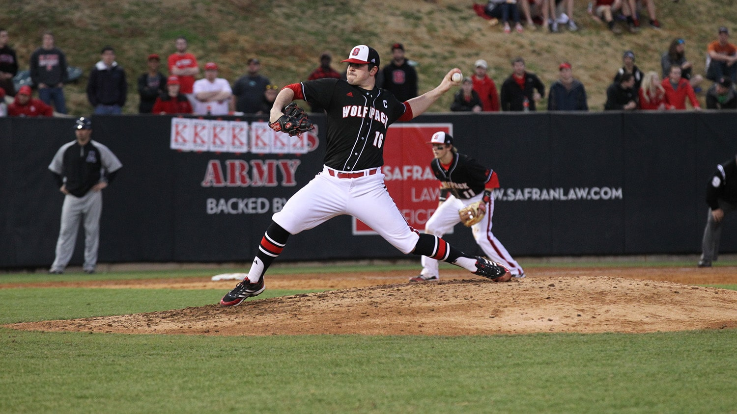 Rodon throws a pitch at a Wolfpack baseball game.