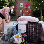 A daughter and father gather dorm items to be moved in.