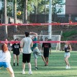 A group plays volleyball.