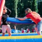Students play on an inflatable game at RecFest.