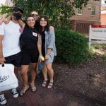 A family poses together during move-in day.