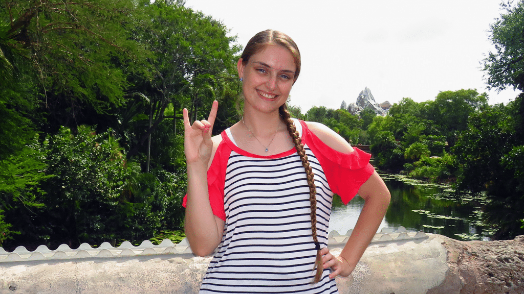 Alex Tobey poses for a photo in Disney World in Orlando.