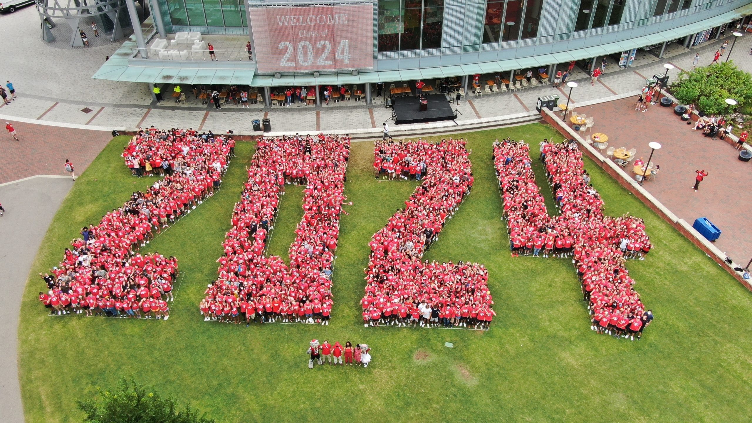 """An aerial photo of students from the Class of 2024 formed to shape """"2024"""" in Stafford Commons."""