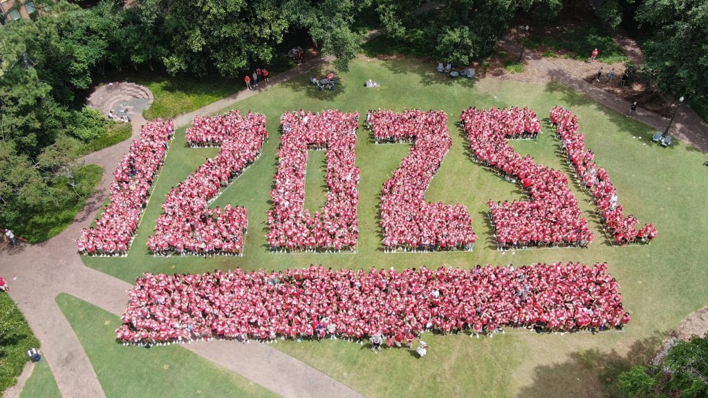"""An aerial photo of students from the Class of 2025 formed to shape """"2025"""" in the Court of North Carolina."""