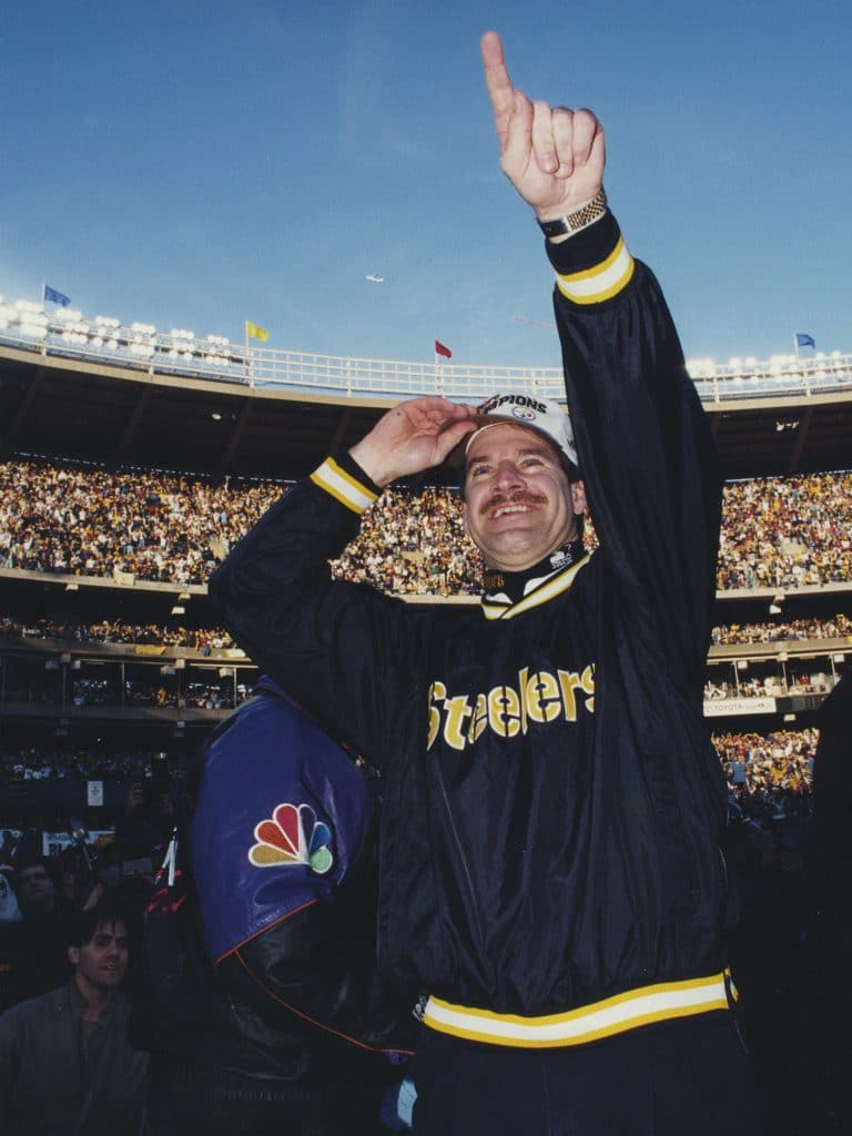 Cowher celebrating a Super Bowl victory on the field.
