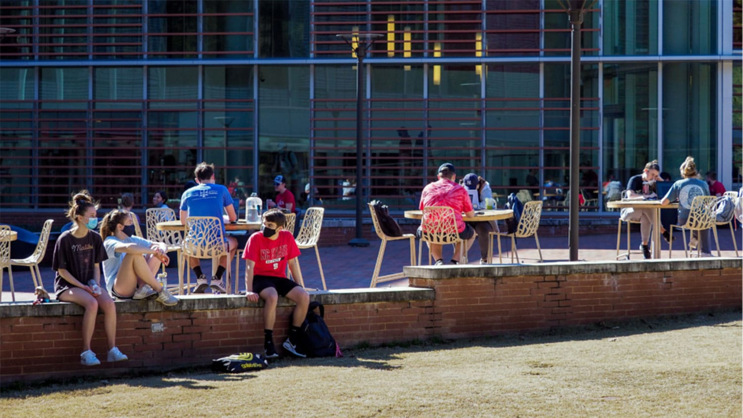 students socializing on NC State's campus