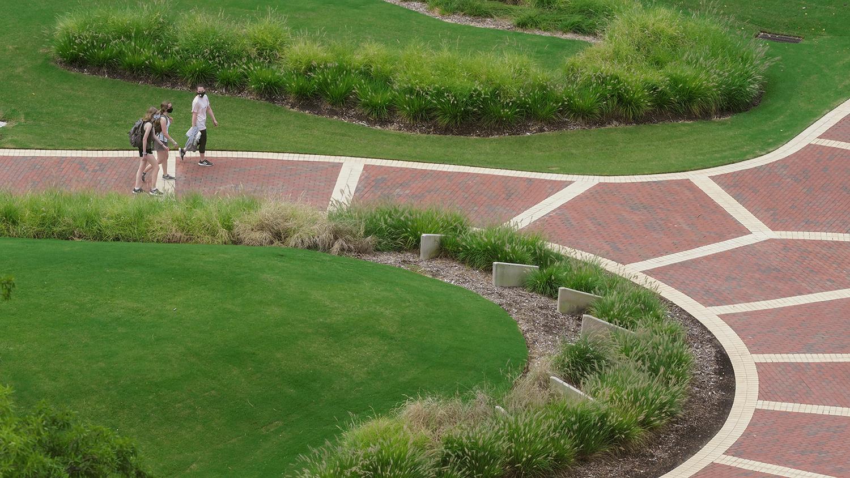 Students walk through the Brickyard.