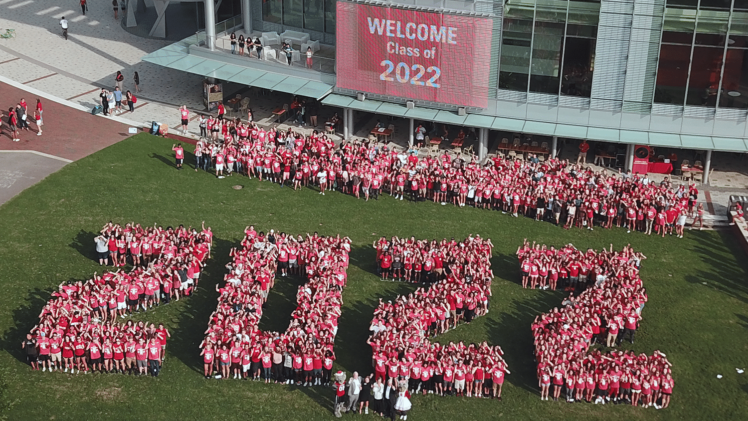 """An aerial photo of students from the Class of 2022 formed to shape """"2022"""" in Stafford Commons."""