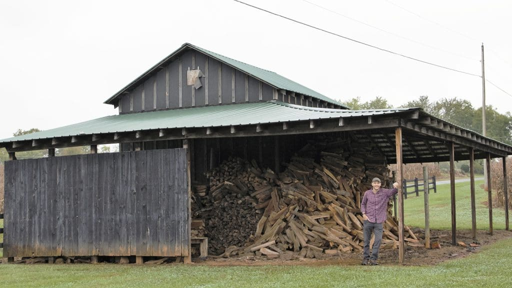 Winemaker Ethan Brown poses in an old tobacco barn at the vineyard.